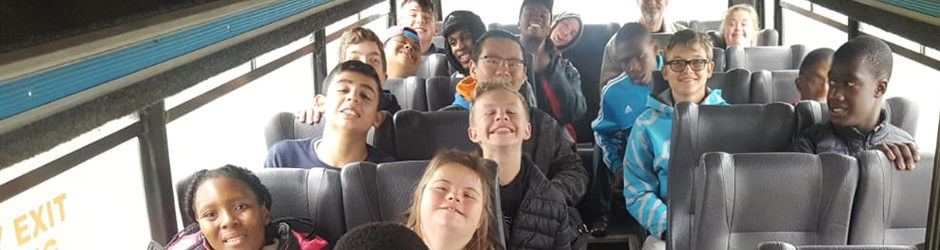 Learners in the bus on their way to camp