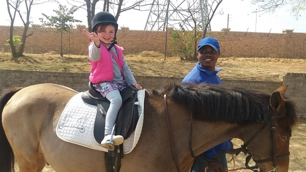 Little McKenzi on horse back