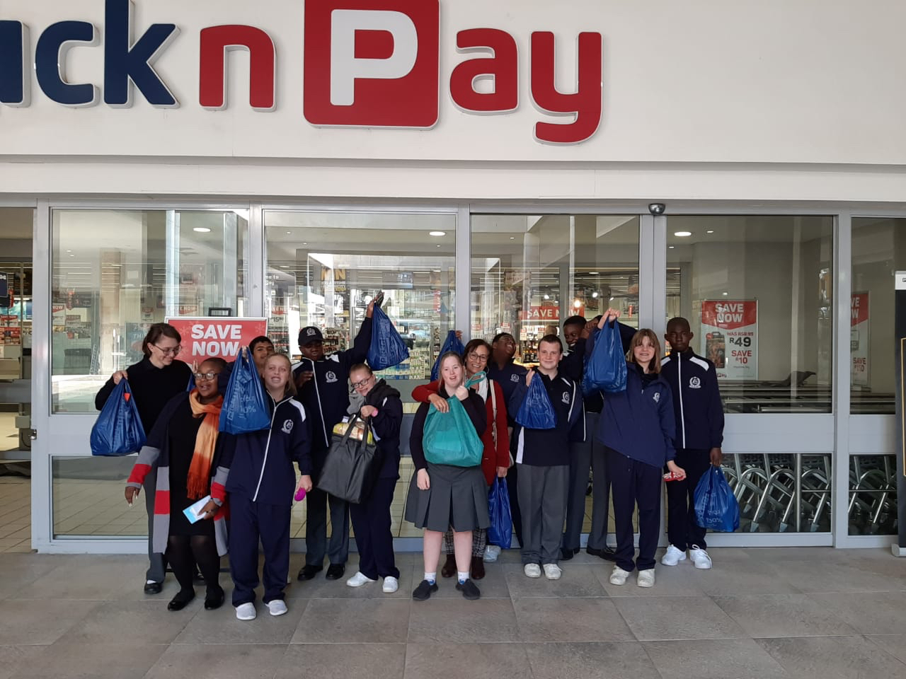 Learners with their shopping bags in front of Pick n Pay Cedar Square