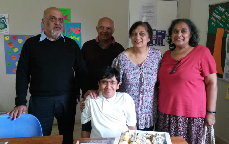 Boy celebrating birthday with family members