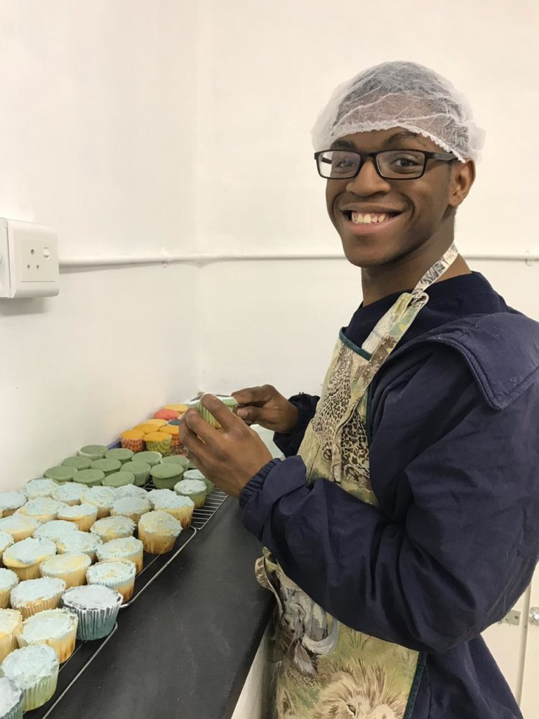 Learner baking cupcakes in vocational kitchen