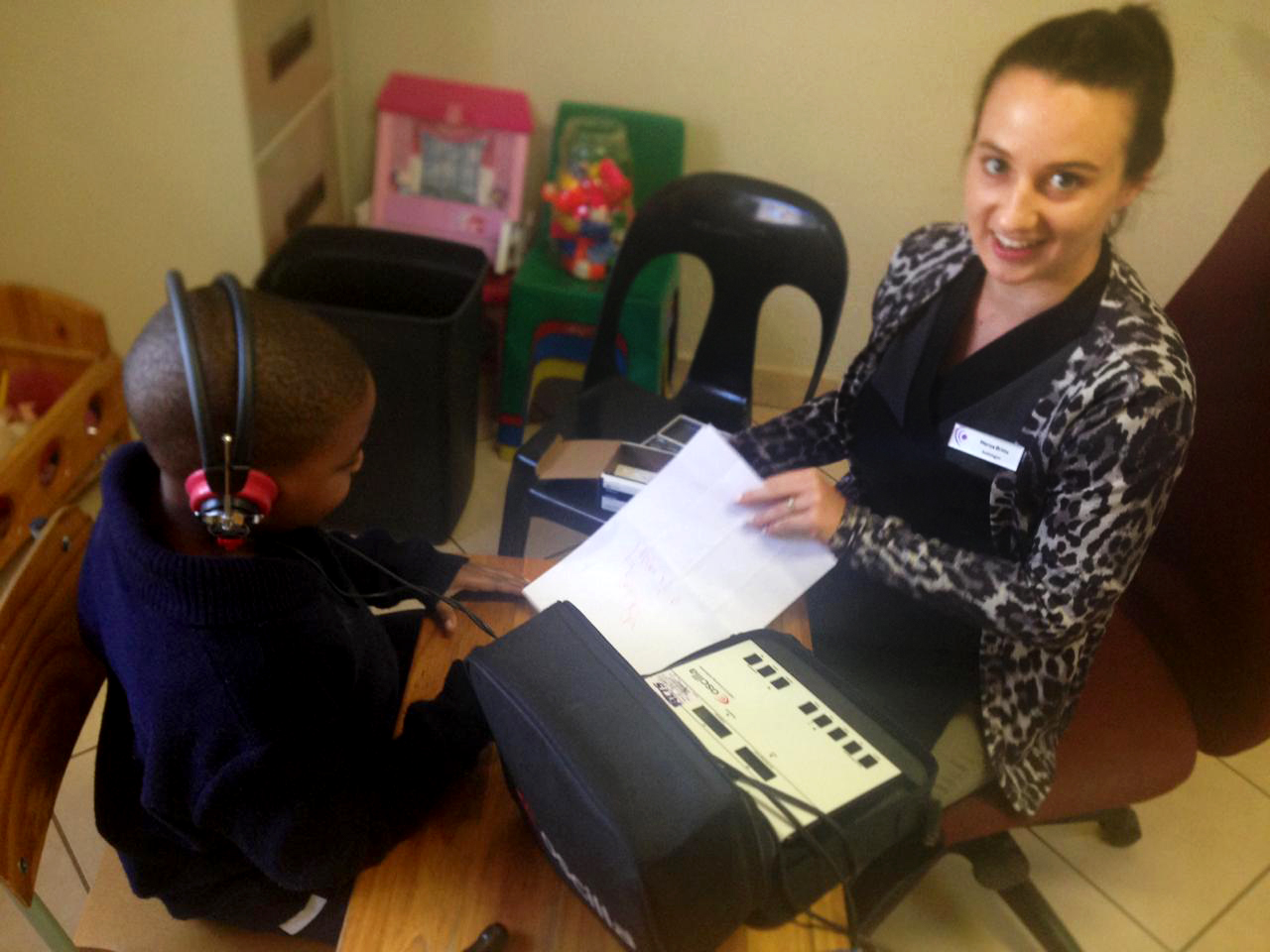Audiologist testing a child's hearing
