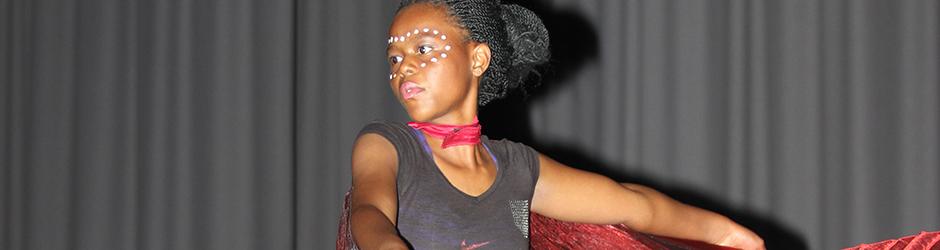 African girl dancing in concert