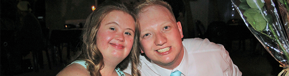 Down Syndrome couple at school dance